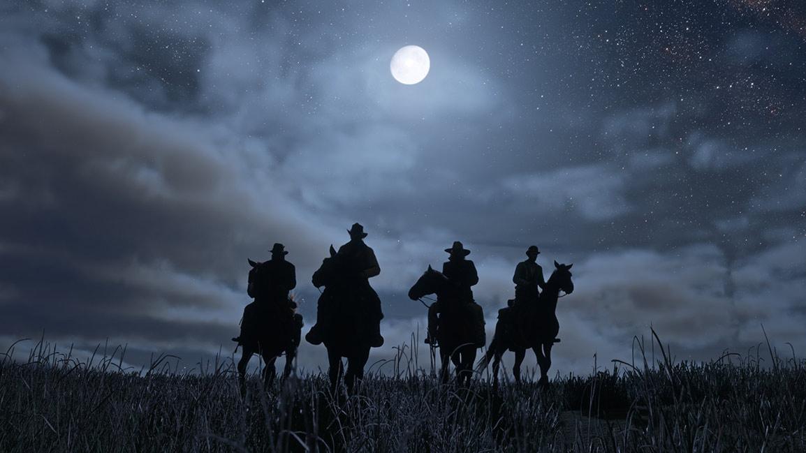 Jinetes andando a caballo por la noche
