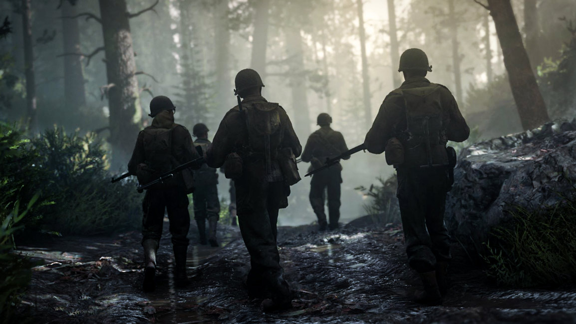 Soldiers walking through forest